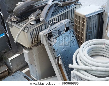 Disposing or collecting and recycling old air conditioners or HVACs. piled old AC units.