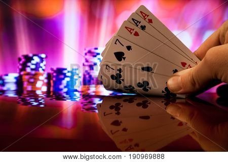 Full house poker cards combination on blurred background casino game fortune