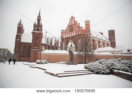 St Anne's and Bernadine's Churches in Vilnius (Lithuania) beautiful architecture of Baltic States in winter during Christmas holidays weekend travel with friends