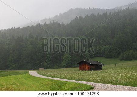 rainy evening at Gerold, Bavaria, Germany road to Alps