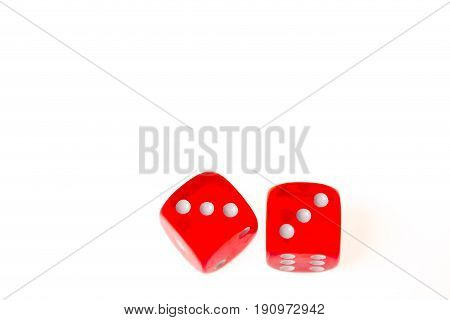 Two red dice both showing a three on the upper face isolated against a white background