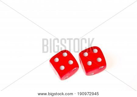 Two red dice both showing a four on the upper face isolated against a white background