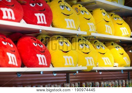 Manhattan, New York City, NY - June 18: View of Red and Yellow MM pillows in the MM Store located in Times Square, NYC, NY on June 18, 2016