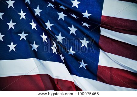 closeup of a flag of the United States fluttering in the wind, with a retro effect
