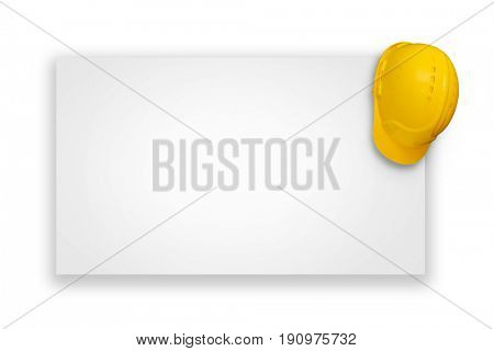 Place for advertisement -Construction helmet hanging on the corner of a white billboard