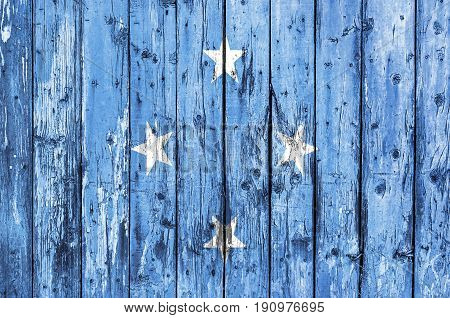 Flag of Federated States of Micronesia painted on wooden frame
