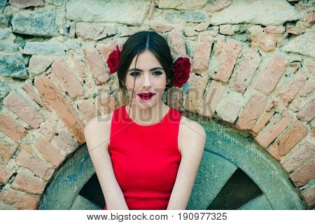 Spanish Woman With Fashionable Makeup And Rose Flower In Hair