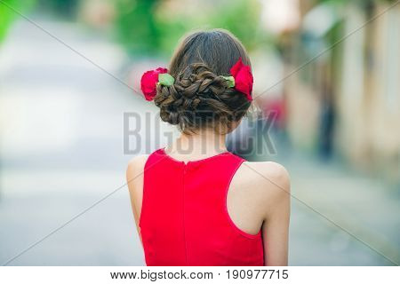 Woman Back View With Red Roses In Stylish Hair