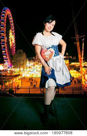 a young woman at the cannstatter wasen in stuttgart, an event very similar to the better-known 'oktoberfest' in munich.