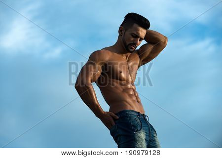 Sexy Man With Muscular Body On Blue Sky