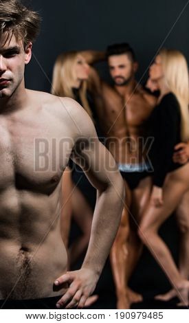 Man With Bare Chest Near Guy And Women