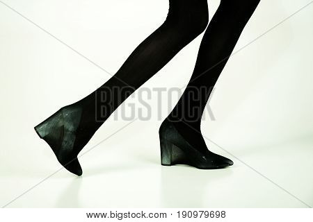 Shoes And Black Tights On Slim Legs Of Girl