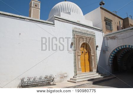 exterior of traditional white arabian house mosque in Tunisia Hammamet