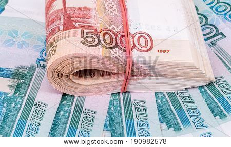 Folded stack of five thousandths banknotes of russian roubles on money background