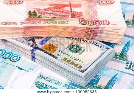 Stack of five thousandths banknotes of russian roubles and dollar banknotes