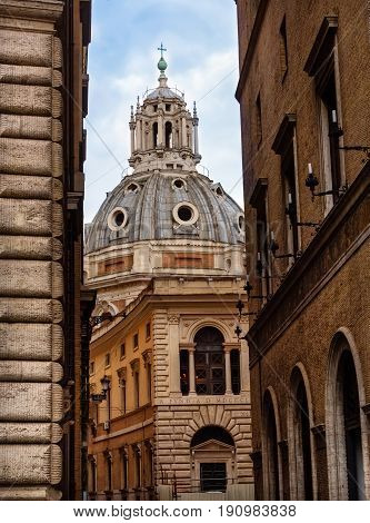 View of Cathedral dome from narrow alleyways and historic architecture in Florence Italy.