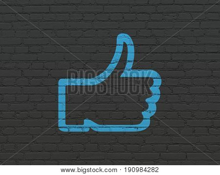Social media concept: Painted blue Thumb Up icon on Black Brick wall background