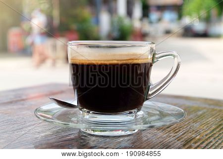 Hot coffee (Americano) on wooden table in relax morning.