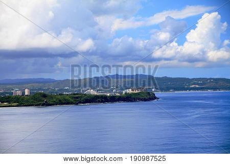 Coastal view of Guam A coastal view of Guam with the business district in the distance seen from the Two Lover's Point