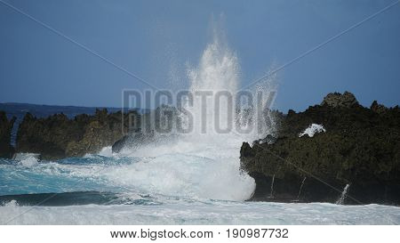 Huge splash against sharp cliffs Huge waves slapping against sharp cliff lines create an amazing view