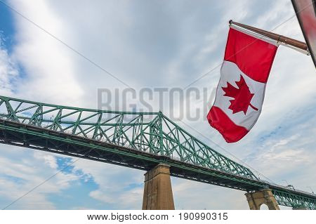 Montreal Jacques Cartier Bridge and Canadian Flag