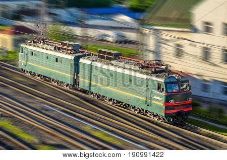 Locomotive electric locomotive on the railway at speed