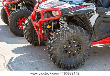 Samara Russia - May 13 2017: Wheels of atv quad bikes parked at the city street