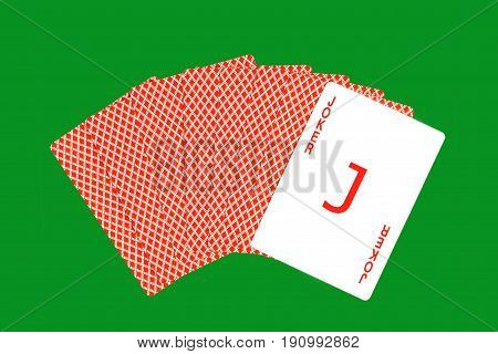 Play cards and Joker card on green casino background taken closeup.