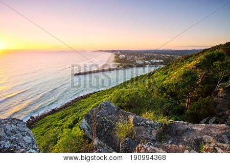 Sunrise over the ocean at Burleigh Heads National Park looking south towards Palm Beach on the Gold Coast in Queensland, Australia