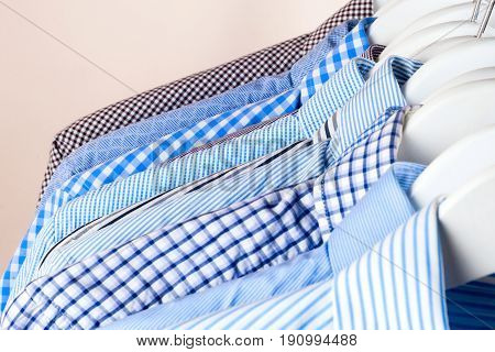 Cloth Hangers With Shirts. Men's Clothes