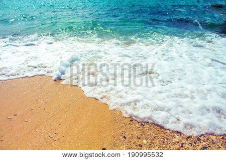 Seaside landscape with sand beach and sea wave. Turquoise blue tropical sea lagoon for perfect vacation. Summer paradise banner template. Tropic seaside photo background. Honeymoon holiday destination