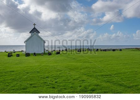 Scenic Varhaug Old Churchyard facing the ocean along Jæren in Rogaland, Norway