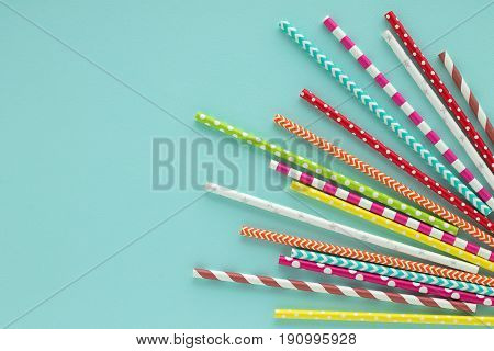 Drinking Paper Colorful Straws For Summer Cocktails On Light Blue Background.