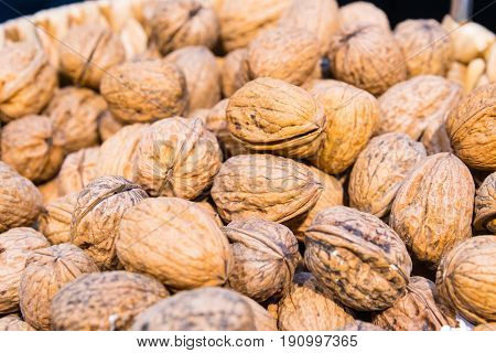 Group of delicious Walnuts with peels. Walnuts background