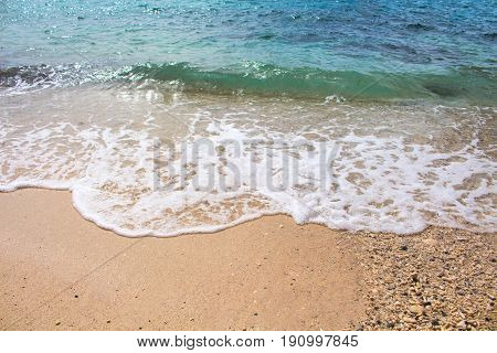 Seashore line with sand beach and sea wave. Turquoise blue tropical sea lagoon for perfect vacation. Summer paradise banner template. Tropic seaside photo for background. Honeymoon holiday destination