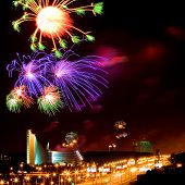 Celebratory fireworks above night city of different colors poster