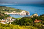 british seaside - summer holiday destination - Lulworth cove on Jurassic coast in southern Devon, UK poster