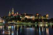 Old town of Krakow with Wawel castle illuminated at night Krakow Poland poster