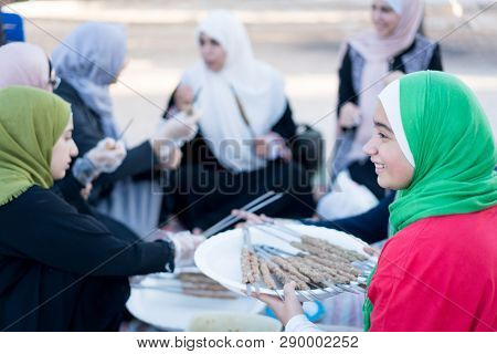 Arab girls ready for barbecue