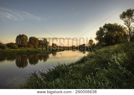 Narrow River Summer Scenery Landscape With Tranquil Water Mirror At Sunset With Clear Sky And Reflec