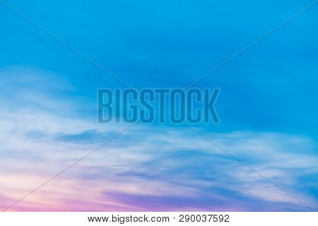 Sunset Sky With Pink Lilac Light Clouds. Colorful Smooth Blue White Sky Gradient. Natural Sunrise Ba