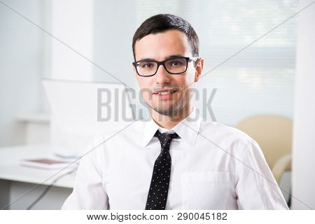 Portrait of young businessman in an office