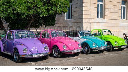 Stari Grad, Hvar, Croatia - Jul 12, 2017: Volkswagen Beetle Cars Park On Side Of Road In Stari Grad
