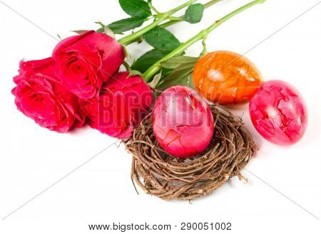 Easter eggs and roses on a white background