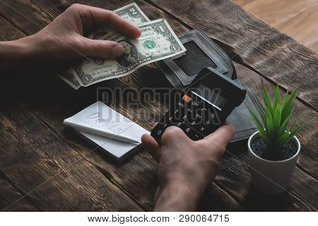 Business man is counting his last dollars from an empty wallet. Tight of money. Lack of money. Financial problems. Bankrupt. Pay the debts concept. poster