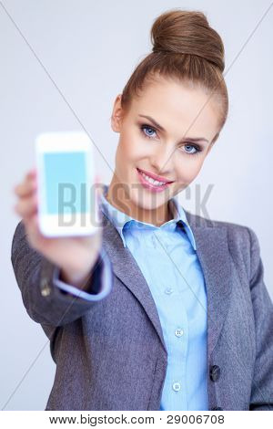Business woman is showing smart phone