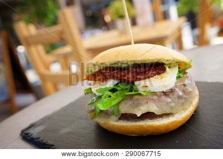 Burger with egg and cheese.