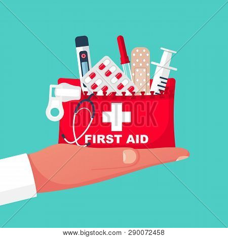 First Aid Kit In Hand Doctor. Medical Equipment And Medications. Healthcare Concept. Vector Illustra