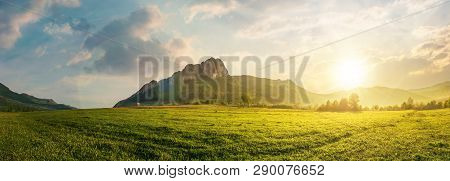 Panorama Of Romania Countryside At Sunset In Evening Light. Beautiful Scenery With Trees In Haze On