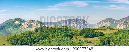 Panorama Of A Landscape With Rocky Ridge. Forested Hill In Front. Wonderful Springtime Scenery. Calm